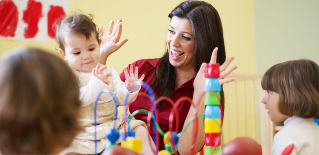 teacher-smile-infant-toddlers